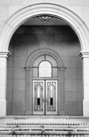 A black and white image of the doors of the Sacramento California Temple.