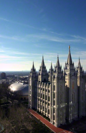 An aerial view of the entire Salt Lake Temple, with the Tabernacle seen behind the temple.