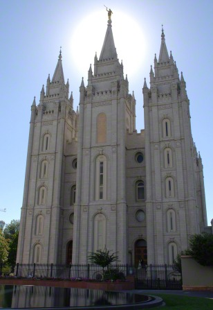 The front of the Salt Lake Temple, with a partial view of the reflecting pond in front.