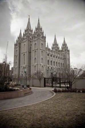 The entire Salt Lake Temple, with a view of the fence around the temple grounds.