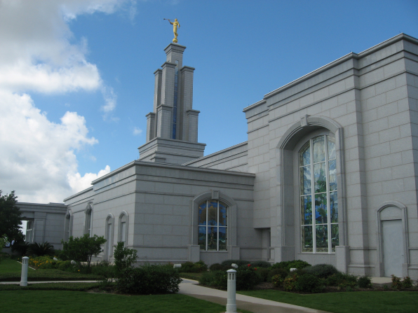 A side view of the San Antonio Texas Temple, with a view of windows and the spire and a partial view of the grounds.