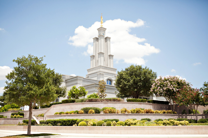 The San Antonio Texas Temple, with a view of the grounds surrounding the temple, including trees and bushes.