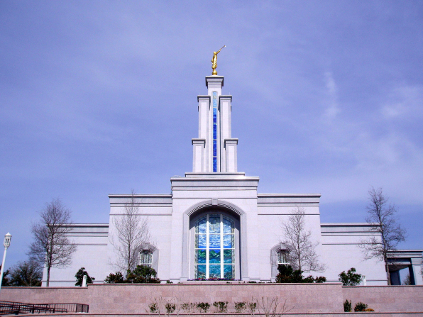 The side view of the San Antonio Texas Temple, with a view of the windows and some trees on the grounds.