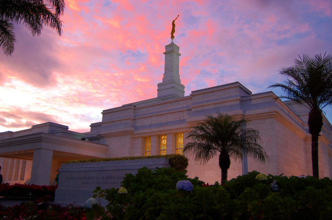 The San José Costa Rica Temple in the late evening, with a partial view of the entrance, the temple name sign, and the grounds.