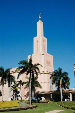 A front and side view of the Santo Domingo Dominican Republic Temple, including a partial view of the entrance.
