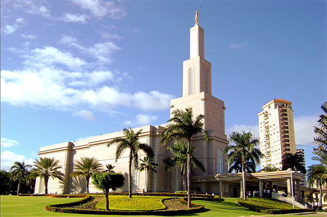 The entire Santo Domingo Dominican Republic Temple, with a view of the grounds and a partial view of the city behind the temple.