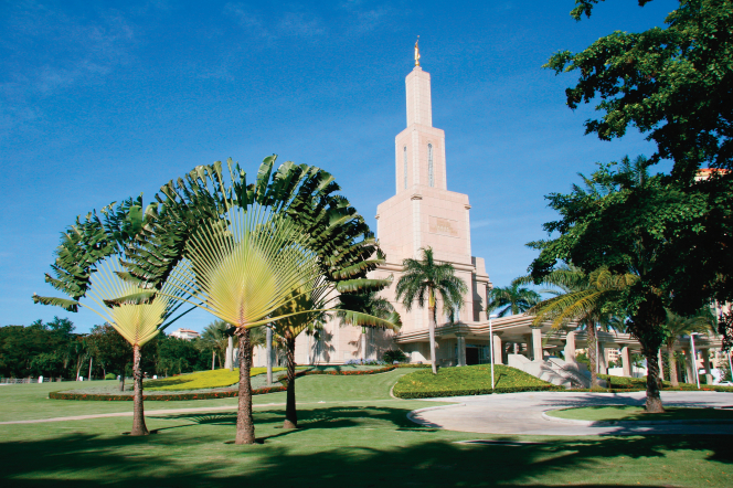A partial view of the Santo Domingo Dominican Republic Temple, with the surrounding grounds covered in different types of trees.