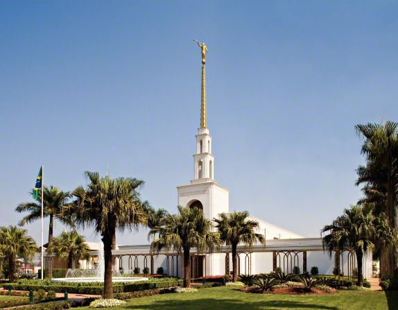 The entire São Paulo Brazil Temple, with a view of the entrance, grounds, trees, bushes, and fountain out front.