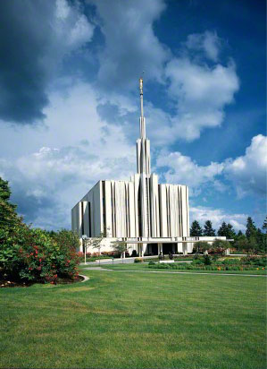 The Seattle Washington Temple, with a view of the spire, entrance, and grounds.