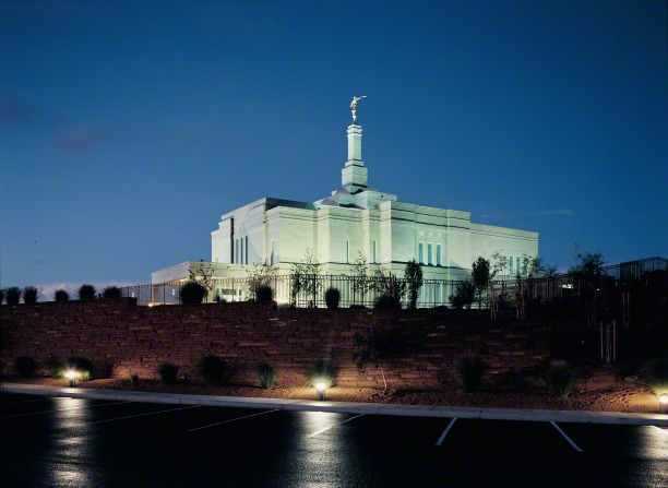 A view of the Snowflake Arizona Temple lit up at night, from the parking lot.