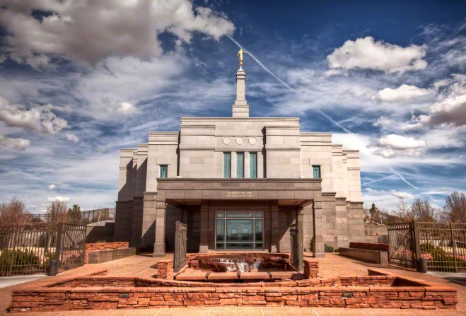 The entrance to the Snowflake Arizona Temple, with a view of the spire, the angel Moroni statue on top, and the fountain on the grounds.