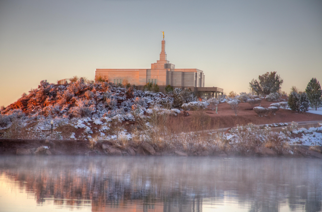 A view of the entire Snowflake Arizona Temple from across a lake. The grounds around the temple are covered in snow.