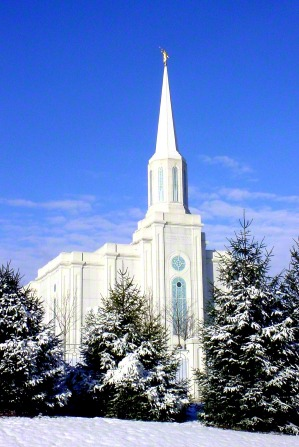 The front of the St. Louis Missouri Temple, with trees in front covered in snow in the winter.