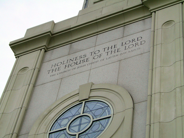 "The inscription ""Holiness to the Lord: The House of the Lord"" over a round window on the St. Louis Missouri Temple."