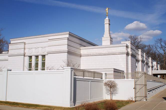 The back of the St. Paul Minnesota Temple, including a view of windows, the spire, and the angel Moroni on top.