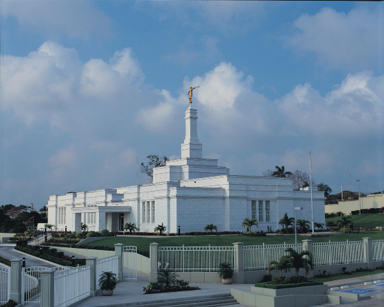 The entire view of the Tampico Mexico Temple, including the grounds, fence, palm trees, and bushes.