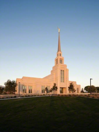 The front entrance to The Gila Valley Arizona Temple in the evening, with the grounds.