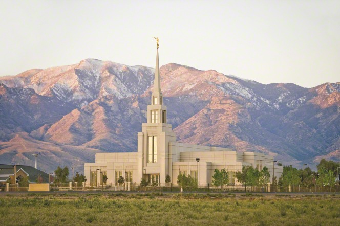 A view of The Gila Valley Arizona Temple, with a view of the surrounding grounds and the mountains in the background.