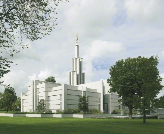 The Hague Netherlands Temple, including the grounds, with trees and bushes.