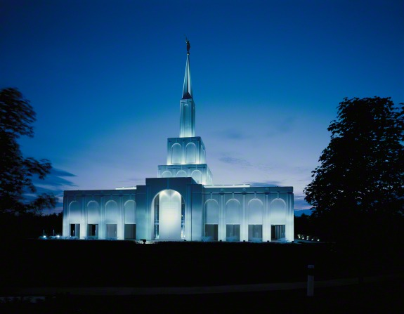 The front entrance to the Toronto Ontario Temple lit up at night.