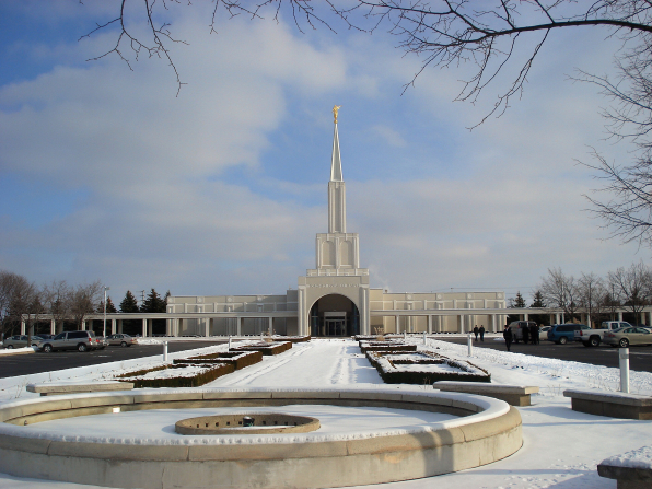 The Toronto Ontario Temple entrance, with the grounds and temple covered in snow.