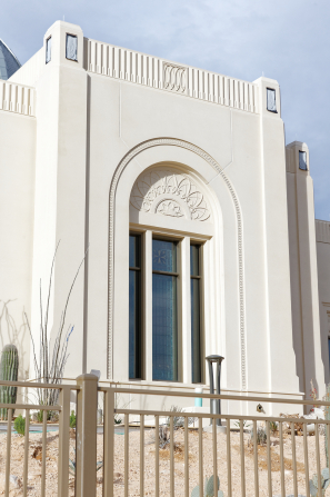 A detail shot of the Tucson Arizona Temple depicting a south-facing window with arch and relief.