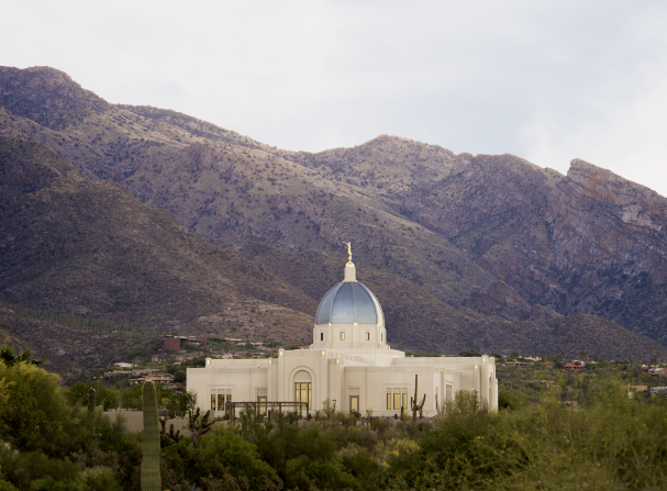 A photograph of the Tucson Arizona Temple framed by the mountains in the distance.