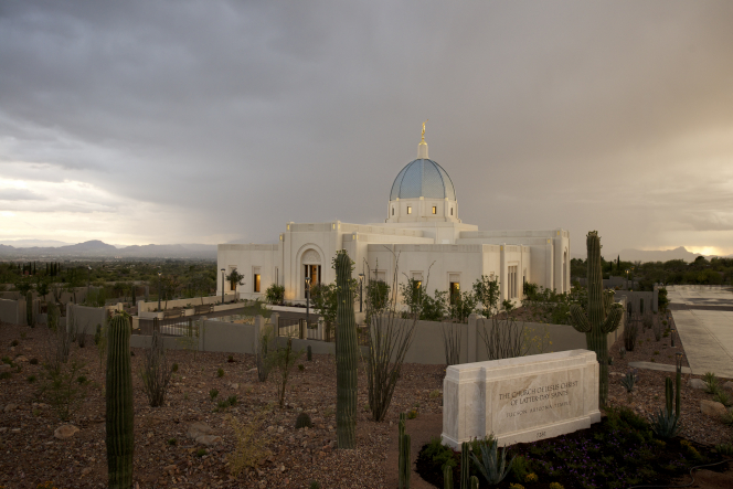 A photograph of the Tucson Arizona Temple beneath a stormy sky.