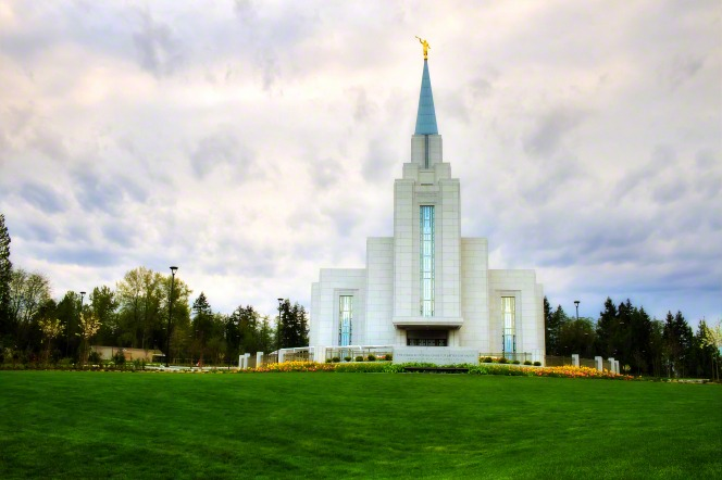 The grounds in front of the Vancouver British Columbia Temple, surrounded by trees.
