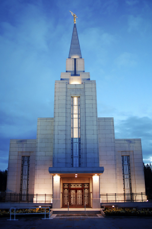 The front entrance to the Vancouver British Columbia Temple, lit up at night.
