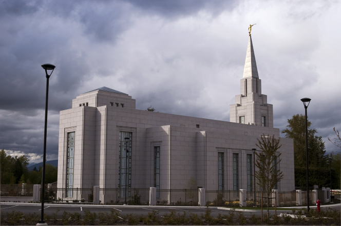A view of the entire Vancouver British Columbia Temple from the side, with the fence surrounding the grounds.