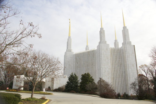 The whole Washington D.C. Temple, with a view from the side and with leafless trees on the grounds.