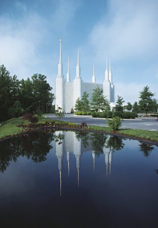 The Washington D.C. Temple during the day, with the reflecting pond in the foreground.