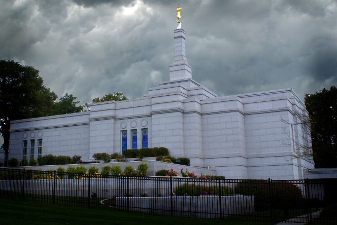 The whole Winter Quarters Nebraska Temple in the evening, with dark gray clouds in the sky.