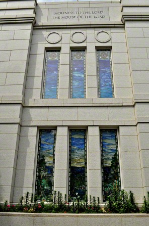 "The stained-glass windows of the Winter Quarters Nebraska Temple underneath the inscription ""Holiness to the Lord: The House of the Lord."""
