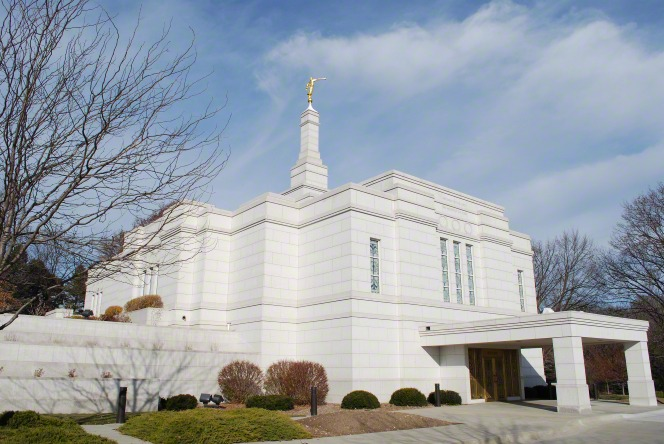 A view of the entire Winter Quarters Nebraska Temple from the left side, including the entrance and grounds, during the winter.