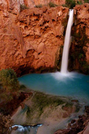 A waterfall descending into a pool at Havasupai, in the Grand Canyon.