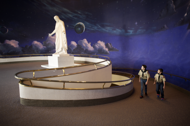 Two Boy Scouts walking up the ramp to the Christus statue in the North Visitors' Center on Temple Square.
