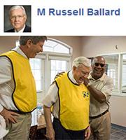 Elder M. Russell Ballard with volunteers working to help those affected by Hurricane Harvey.